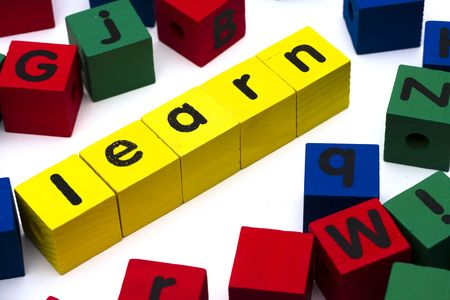 Alphabet blocks spelling learn on white background photo