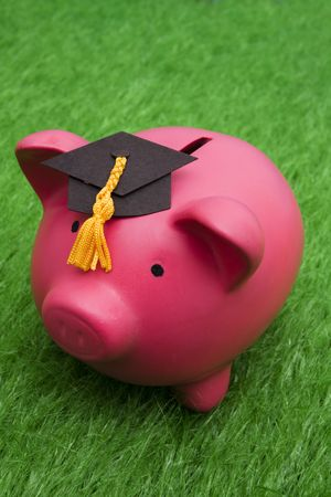 cost of education: Piggy bank with graduation cap � cost of education