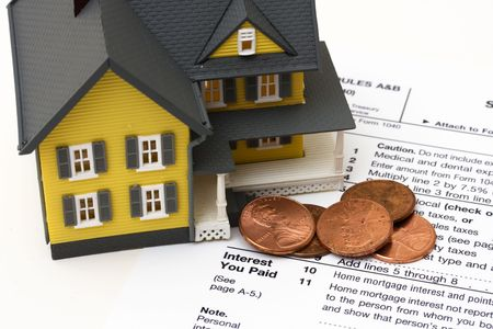 tax return: House with money and tax paper – mortgage deduction