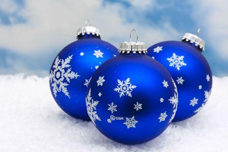 copy space: Blue Christmas balls on snow