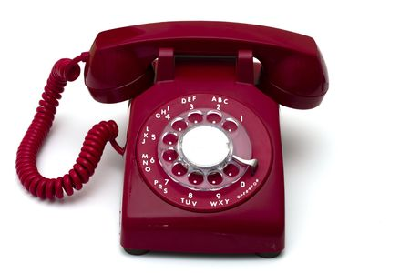 receiver: Red rotary telephone isolated a white background
