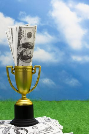 place to shine: Trophy with money on grass with copy space Stock Photo