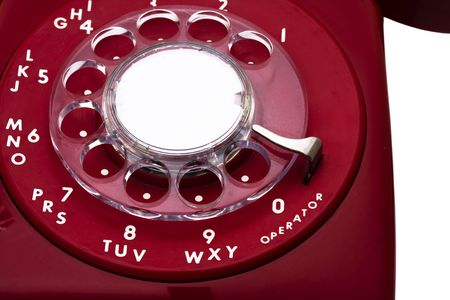 Red vintage rotary telephone – close-up over white Stock Photo - 2839924