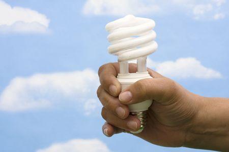 Energy saving light bulb on sky background Stock Photo - 3068309