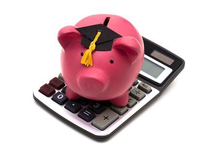 Piggy bank with graduation cap and calculator isolated on white Stock Photo - 3093256