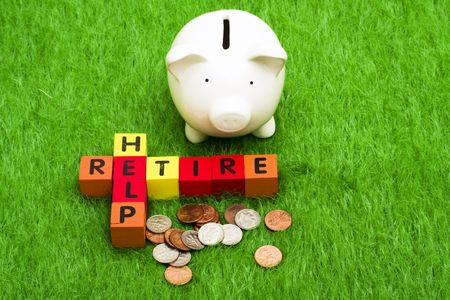 Alphabet blocks spelling retire and help with a piggy bank and coins Stock Photo - 3093259