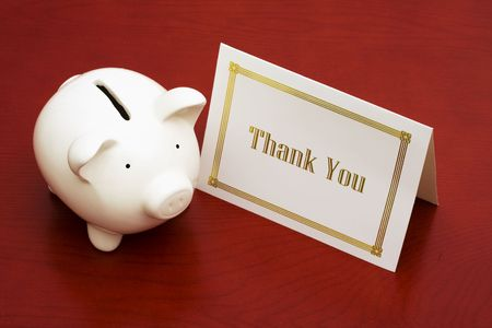 Thank you card and a piggy bank Stock Photo - 3113378