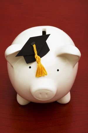 cost of education: Piggy bank with graduation cap � the cost of education