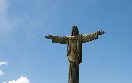 Jesus statue with sky background with copy space photo
