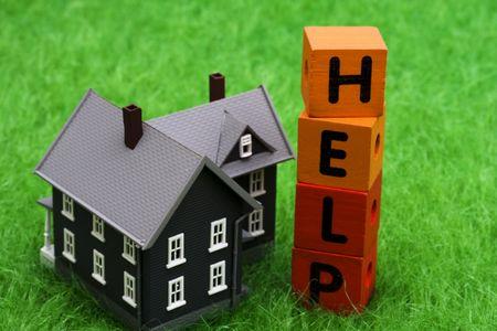 subprime: House with alphabet blocks spelling help