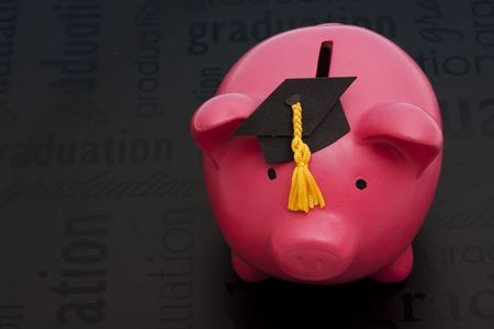 cost of education: Piggy bank with a graduation cap � cost of education Stock Photo