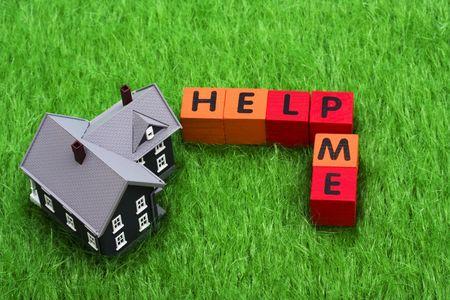 help me: House with alphabet blocks spelling help me Stock Photo