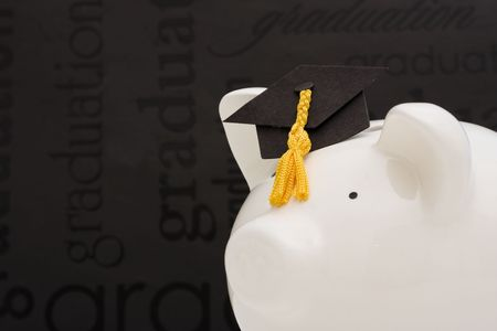 loans: Piggy bank with graduation cap �cost of education Stock Photo