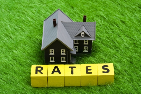 rates: House with alphabet blocks spelling rates Stock Photo