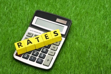 loaning: Calculator with alphabet blocks spelling rates - calculating payments Stock Photo