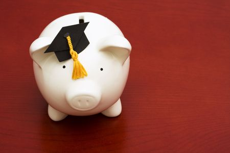 Piggy bank with graduation cap – cost of education photo