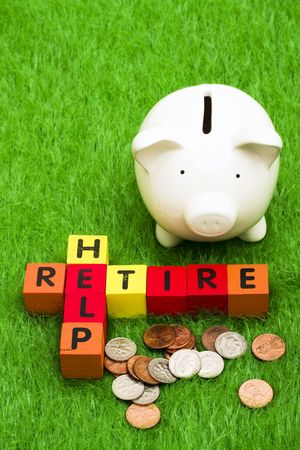 retire: Alphabet blocks spelling retire and help with a piggy bank