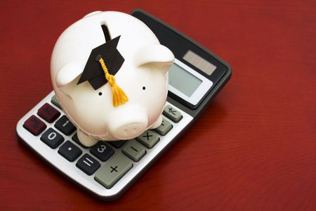 Piggy bank with graduation cap and calculator Stock Photo - 3251370