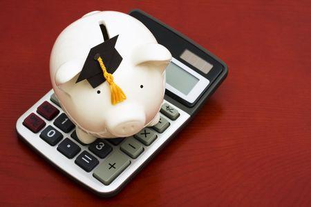 Piggy bank with graduation cap and calculator Stock Photo - 3251370