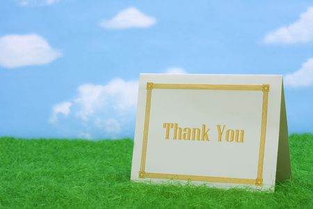 Thank you card on grass with copy space