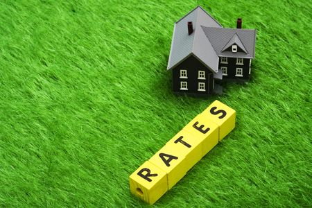 House with alphabet blocks spelling rates – mortgage rates Stock Photo - 3259281
