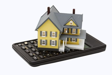 Model house sitting on calculator isolated on a white background Stock Photo - 3260054