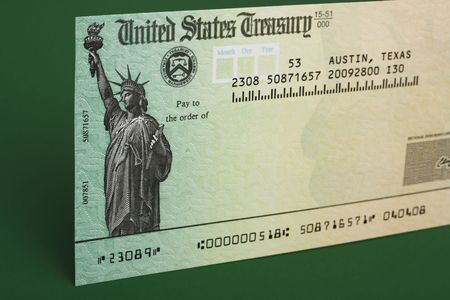 deduct: Tax refund cheque with a green background Stock Photo