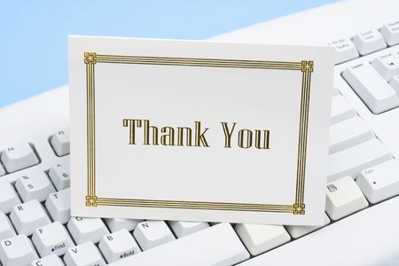 Thank you card on a white keyboard photo