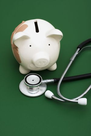 retirement nest egg: Piggy bank with adhesive bandage, the health of your finances