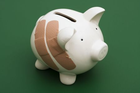 health equity: Piggy bank with adhesive bandage, the health of your finances