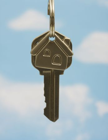 House key on keychain on a blue background Stock Photo - 3323692