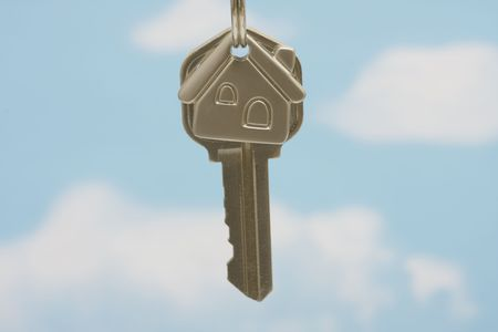 loaning: House key on keychain on a blue background