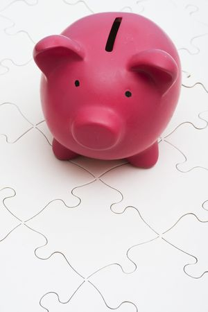 ins: Piggy bank sitting on puzzle, understanding the ins and outs of investing