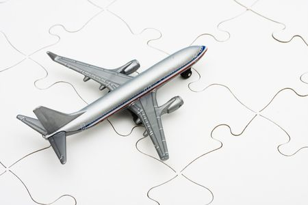 figuring: Airplane on puzzle, the problem of figuring out all the changes in flying nowadays Stock Photo