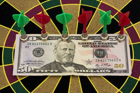 Magnetic dart board with darts � on target with your money photo