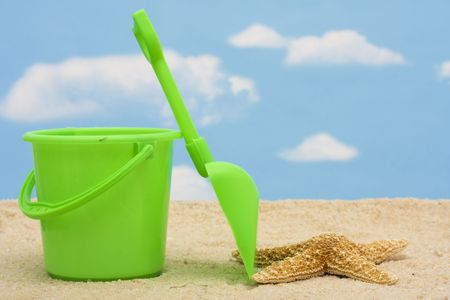 Shovel and bucket in sand � summer time fun Stock Photo - 3358479