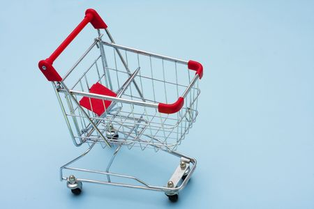 shopping buggy: Shopping Cart on blue background with copy space