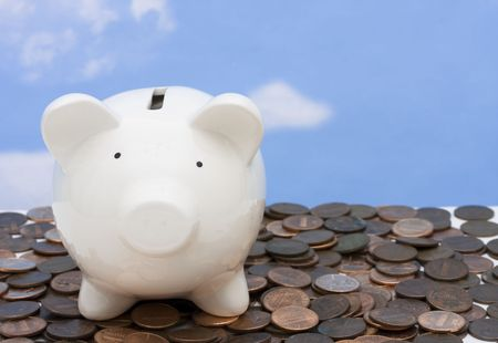Piggy bank on a pile of coins Stock Photo - 3362875