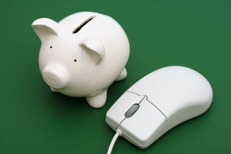 Piggy bank with computer mouse on a green background Stock Photo - 3369281