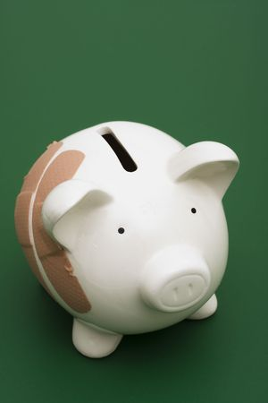 Piggy bank with adhesive bandage, the health of your finances photo