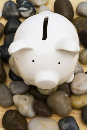Piggy bank on rocks � troubled times in the financial and banking world photo