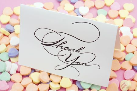 greet card: Thank you card on candy heart background