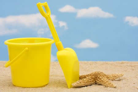Shovel and bucket in sand – summer time fun Stock Photo - 3377768