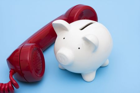 Telephone with piggy bank � call for help photo
