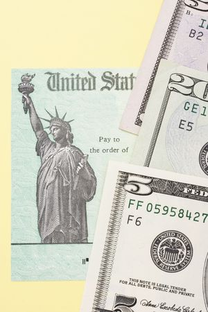 federal tax return: Close up of part of a tax refund cheque with money