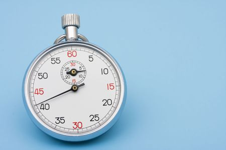 Stopwatch on blue background – a quick response Stock Photo