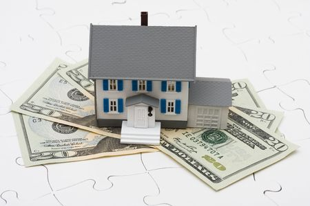 understanding: House sitting on money with puzzle. Understanding mortgages