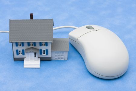 purchased: House sitting with computer mouse – online real estate