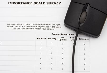 excellent: Close up of survey with computer mouse, excellent customer service