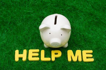 help me: Piggy bank with the words help me. savings help Stock Photo